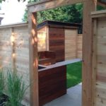 Cedar fence with IPE Barn door in background