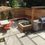 Design Build - Oversize flagstone slabs, outdoor kitchen, IPE bench with fire pit