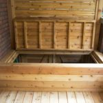 Front porch with built in garbage storage bench