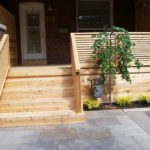 Front porch with built in garbage storage bench(4)