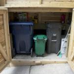 Front porch with garbage bin storage