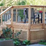 Cedar deck surrounding above ground pool