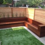 IPE Bench and Planter, artificial grass with cedar fence and Indian flagstone