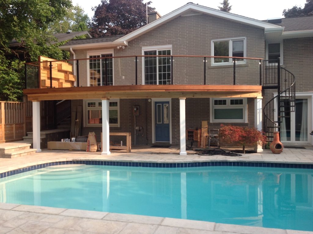 IPE Deck with glass railing and spiral staircase