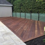 IPE deck with smoked glass railing